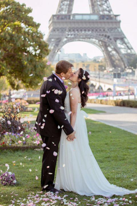 Eiffel Tower ceremony kiss flower petal toss
