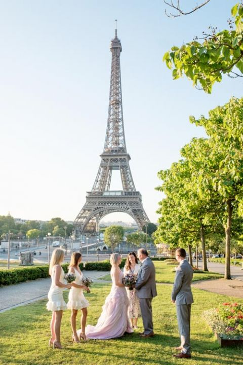 Family vow renewal Eiffel Tower gardens